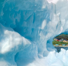 greenland town narsaq through iceberg