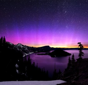 aurora borealis and the milky way over crater lake