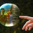 reflection in popping bubble