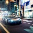 chrome lamborghini aventador on streets of tokyo