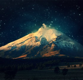 starry sky over snowy mountain
