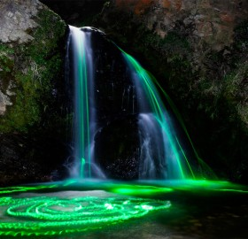 long exposures taken with glow sticks in waterfalls
