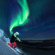 skiing under northern lights, finland