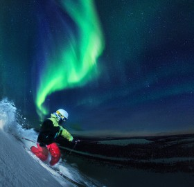 skiing under northern lights, finland