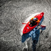 kayaker in a pool of mesmerizing foam