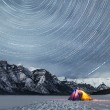 star trails above rocky mountains