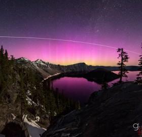 pink aurora over crater lake, oregon