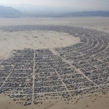"aerial view of the ""burning man"" music festival"