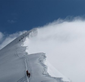 climbing to a cold and windy weissmies