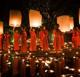 monks at loy krathong festival, thailand