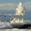 winter hits st. joseph lighthouse, michigan lake