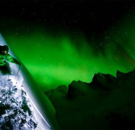 skiing under aurora borealis