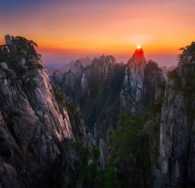 sunset over huang shan, china