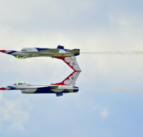 two planes flying at high speed performing a mirror image