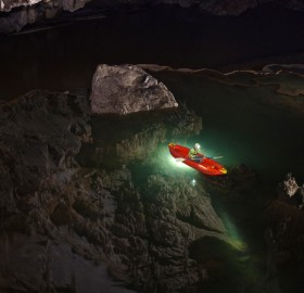 kayaking in clear cave lake, thailand