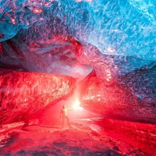 lighting a flare inside iceland ice cave