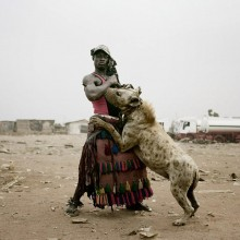 a man with his pet hyena