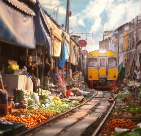 a train goes through market, bangkok