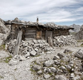 stone and wood mountain shack, austria