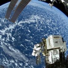 astronaut takes spacewalk