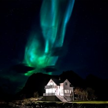 aurora borealis over house, norway