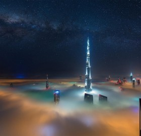 dubai at night above the clouds