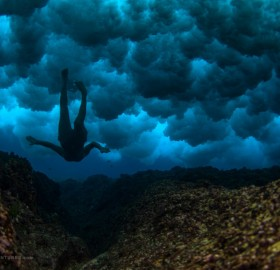 swiming under sea clouds