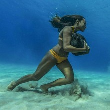 Hawaiian Surfer Trains Across The Ocean Floor With A 50 Pound Rock