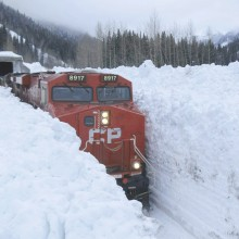 Train Rumbling Through Snow Banks, Canada