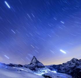 Stars In The Night Sky Over Matterhorn Mountain, Switzerland