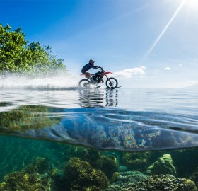 Riding Dirt Bike On Clear Waters Of Tahiti