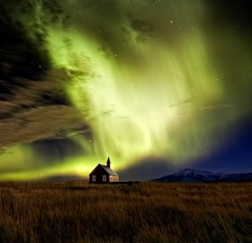 Solar Flare Over Small Church In Iceland