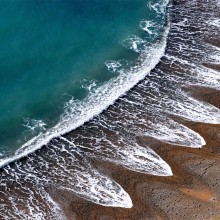 Waves Creates A Pattern On A Beach In Dorset, England