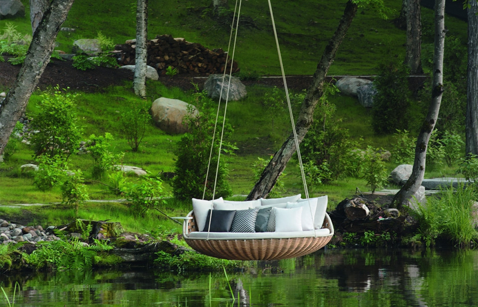 swinging couch over lake