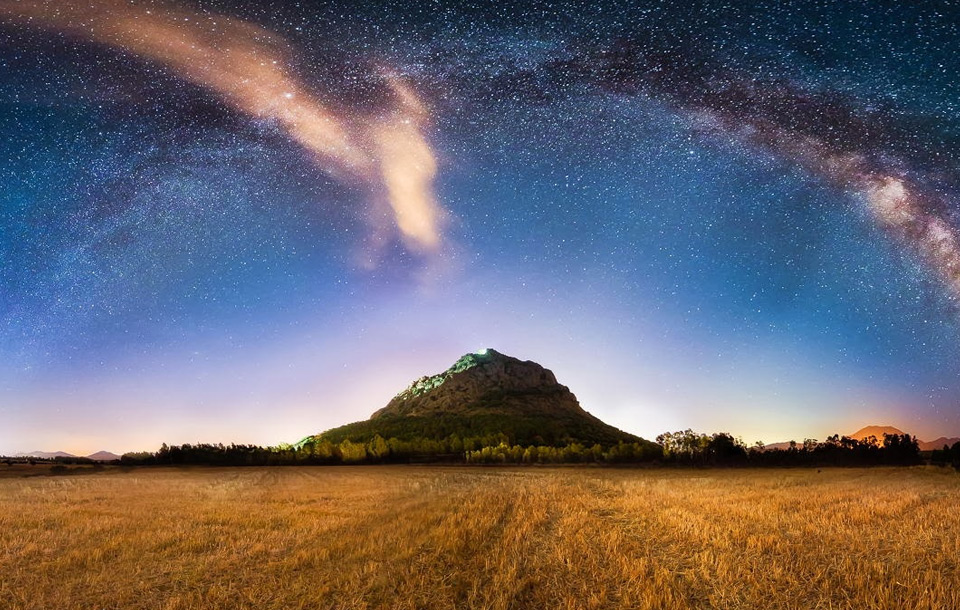 milky way over field, italy
