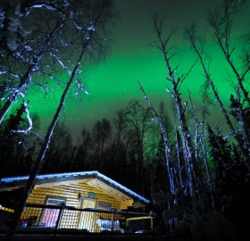 cabin under northern light
