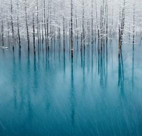 snow on a blue pond