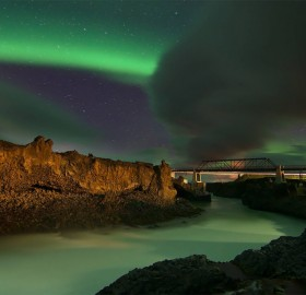 aurora borealis over skjálfandafljót river in iceland