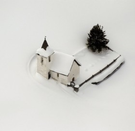 church in switzerland surrounded by snow