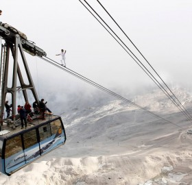 balancing on the ropeway of a cable car, germany