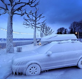 ice covered car by the frozen lake geneva