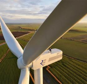 man on a wind turbine
