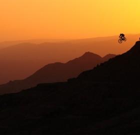 biker airs into a sunset