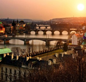 as the sun sets over prague