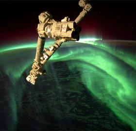 space station above aurora borealis