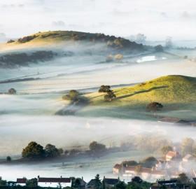 mist over countryside, england