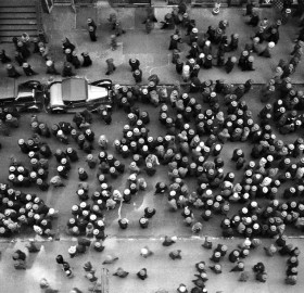overhead view of men wearing hats, nyc, 1930