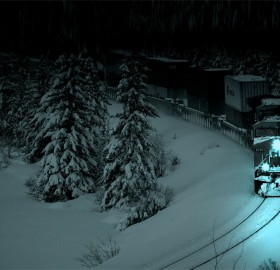 a train passing through snow