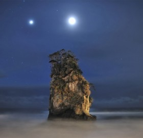 jupiter and moon above rock formation, japan