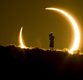 person framed by the annular solar eclipse